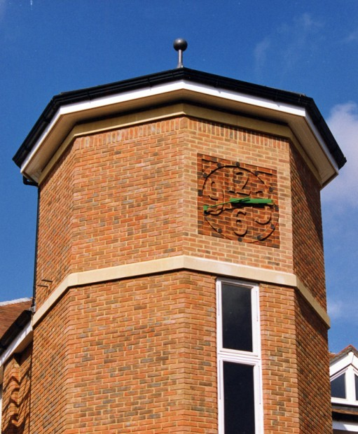 tonbridge-school-brick-carving-clock